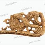 Фрагмент костяной накладки с изображением дракона.