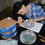 Анна Кашникова выполняет археологический рисунок